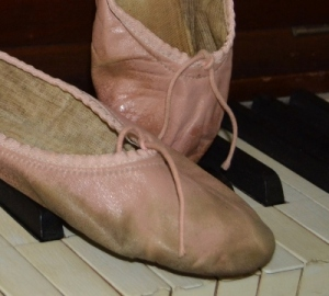 Ballet slippers on keyboard