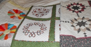 From left to right: Dresden Plate, Celtic Quilt, Double Wedding Star (my wedding quilt)