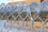 "Chain Link Fence: ""The wide world is all about you: you can fence yourselves in, but you cannot forever fence it out."" - J. R. R. Tolkien"