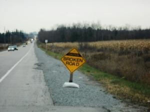 Broken Road Sign