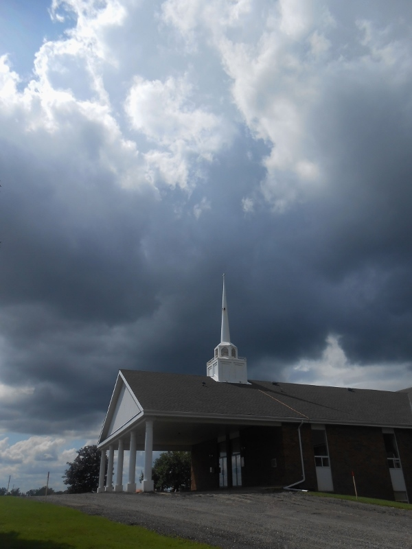 Stormy clouds over church